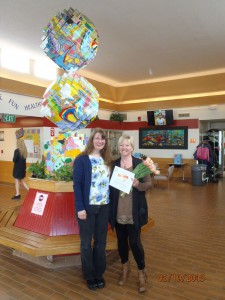 Teri Diamond is pictured with Debbie Harris, AAEC President, after receiving her reward. They are in front of a student made sculpture.