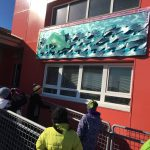 kids look at public art at a clinic