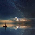 A boat on the ocean at night